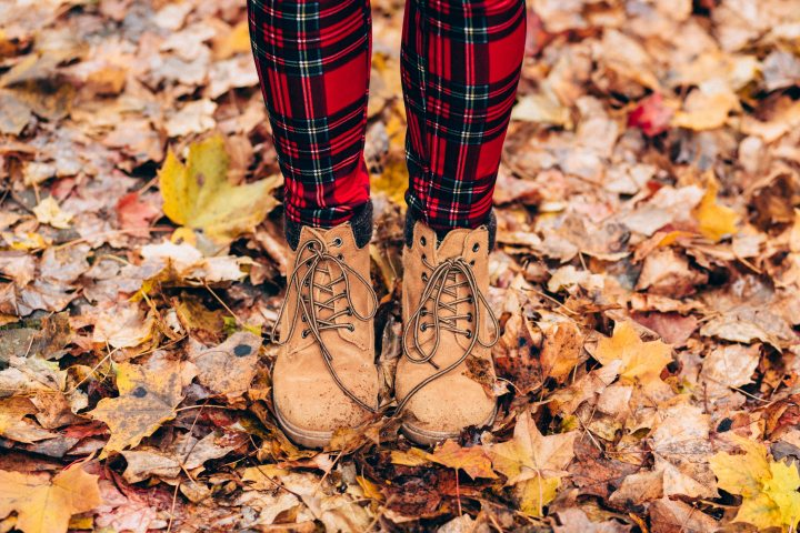 fall or autumn boots and dry leaves